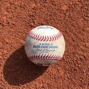 A MLB Baseball on Ground