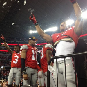 Evan Spencer and Michael Thomas Celebrating on Podium Postgame Nati Championship 1-12-15