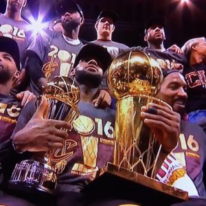 LeBron Holding Both NBA Championship and MVP Trophies
